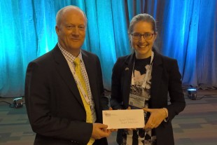 John Clarke, NDA CEO, with Hannah Paterson, winner of Best Student Poster Award at WM2016