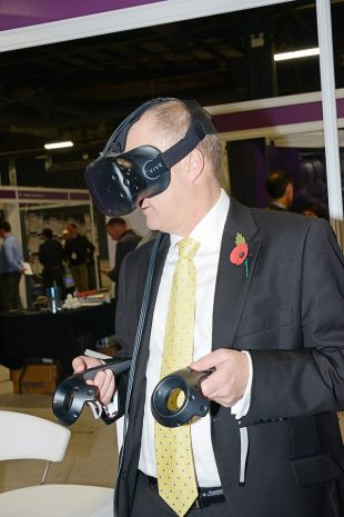 NDA CEO, John Clarke, tests out a virtual reality headset provided by Clicks & Links in our Innovation Zone