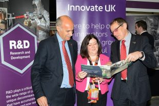 Derek Allen, Innovate UK, with Melanie Brownridge and Adrian Simper at R&D stand