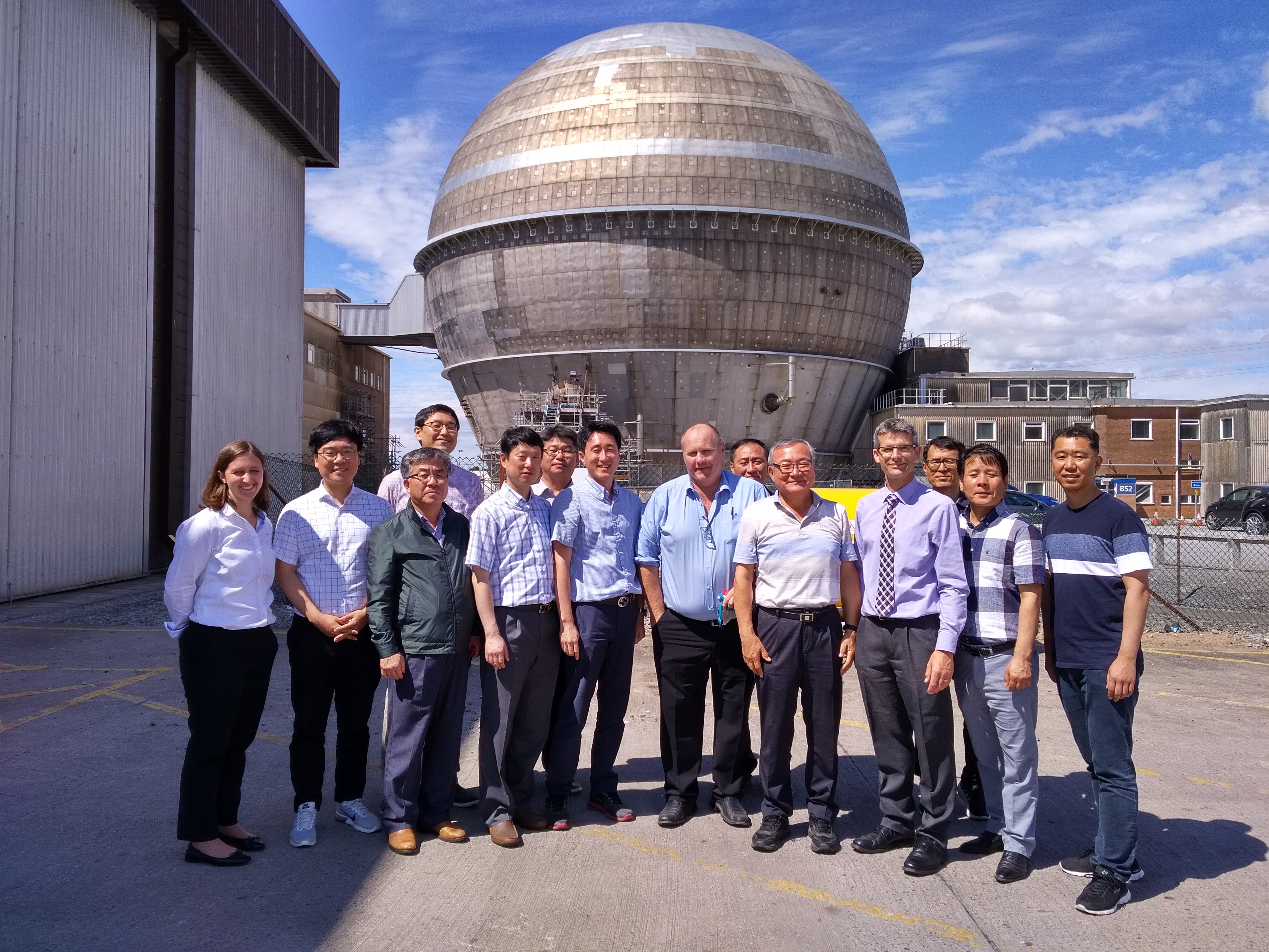 Korean visitors and hosts outside Sellafield's Windscale Advanced Gas-Cooled Reactor (WAGR)