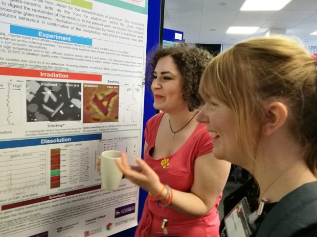 Researchers discuss their project at an event for one of the earlier programmes