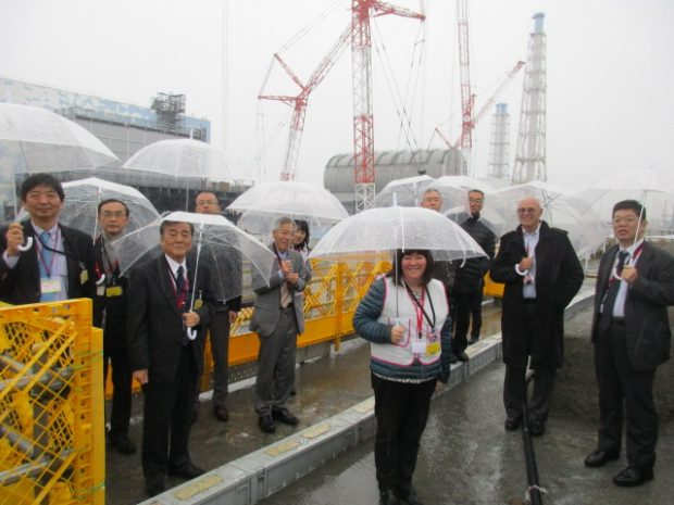 Umbrellas were required for members of the panel visiting Fukushima