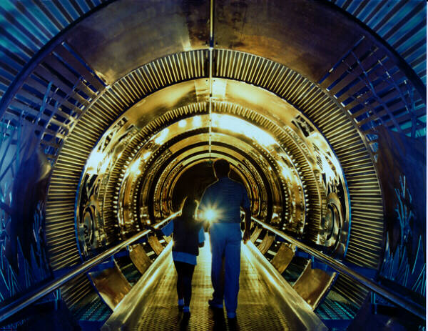 2 people working through a tunnel into Sellafield Visitors' Centre