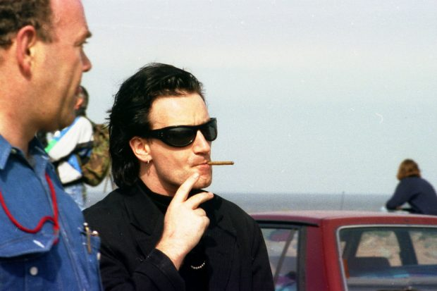 The rock star 'Bono' on Seascale beach smoking a cigar