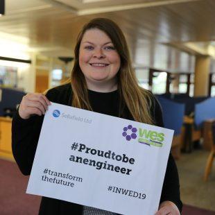Joanne Griffen holding sign that says Proud to be an engineer, transform the future #INWED19