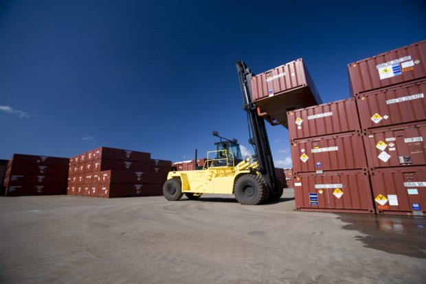 A forklift truck lifting a container at the Low Level Waste Repository