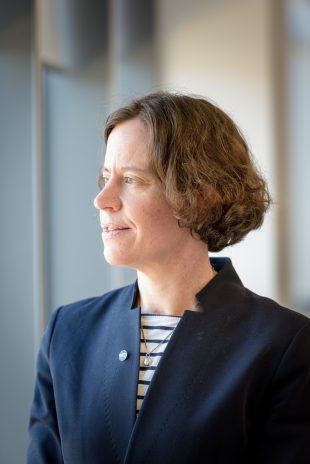 A portrait picture of Rebecca Weston wearing a navy blue suit