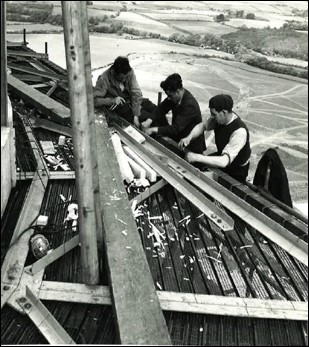 Black and white image of Sellafield workers on top of the Pile Chimney with no protective clothing on