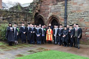 A line up of Project Academy graduates at Carlisle Cathedral