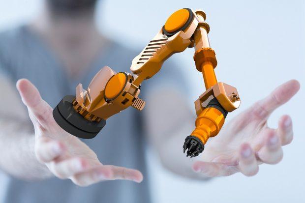 Human hands holding a robot