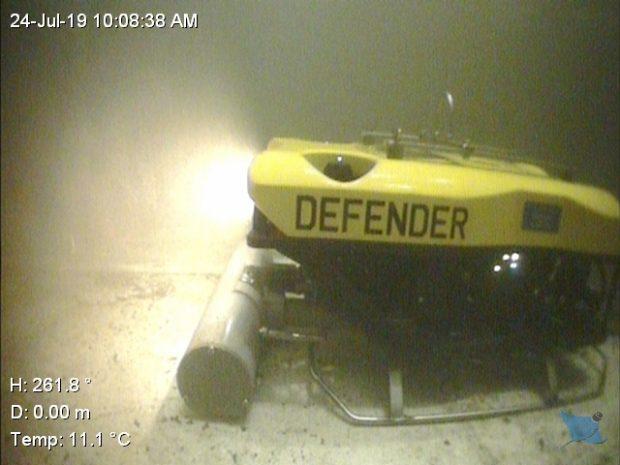 Defender in action under water