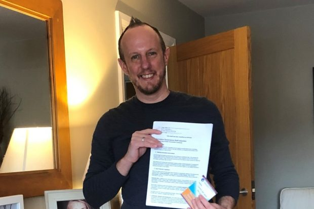 Matt Legg standing with his volunteering training certificate
