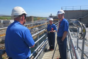 Martin Chown talking to employees standing on the gantry of FGMSP