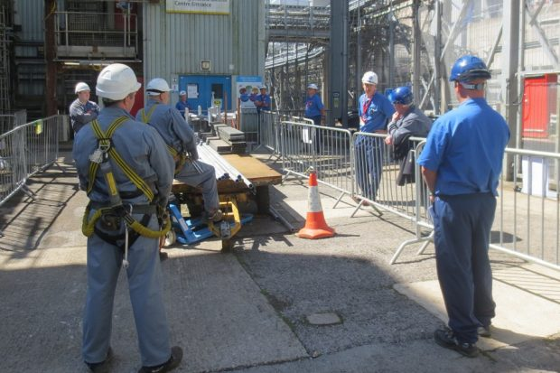 Scaffolding employees meeting Martin Chown