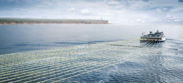 Ship at sea trailing seismic sensors